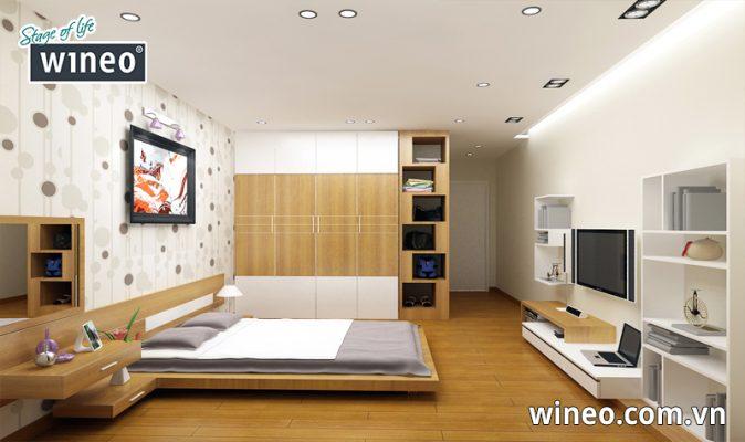 Sàn gỗ màu vàng nhạt cùng tông với màu nội thất trong phòng tạo cảm giác nhẹ nhàng dễ chịu